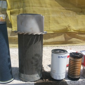 Manitou secondary air filter, primary air filter , engine oil filter, fuel filter, and fuel oil/water separator (From left to right).